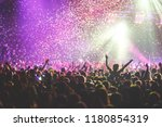 a crowded concert hall with... | Shutterstock . vector #1180854319