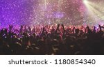 a crowded concert hall with... | Shutterstock . vector #1180854340