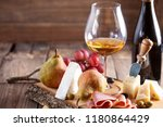 glass and bottle of wine with... | Shutterstock . vector #1180864429