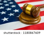 hammer of the judge on the flag ... | Shutterstock . vector #1180867609