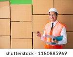 man contractor working in box... | Shutterstock . vector #1180885969