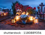 candles burning at a cemetery... | Shutterstock . vector #1180889356