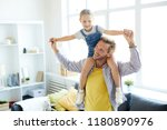 happy dad holding his little... | Shutterstock . vector #1180890976