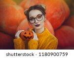 a cozy autumn photo of a girl... | Shutterstock . vector #1180900759