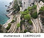 serpentine paved road descent... | Shutterstock . vector #1180901143