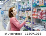 Woman near counter in pharmacy drugstore - stock photo