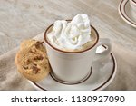a steaming cup of hot chocolate ... | Shutterstock . vector #1180927090