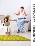 man ironing  his lazy wife... | Shutterstock . vector #1180933993