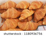 french croissants in the market | Shutterstock . vector #1180936756