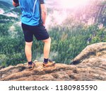 hiker legs climbing on sunrise... | Shutterstock . vector #1180985590