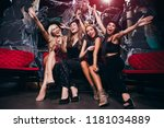 Stock photo come celebrate with us four beautiful young women in evening gown looking at camera with smile 1181034889