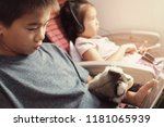 asian kids using smart phone in ... | Shutterstock . vector #1181065939