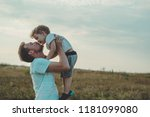 young father throws up his cute ... | Shutterstock . vector #1181099080