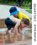 toddler boys playing in water... | Shutterstock . vector #1181144530