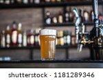 pint of white beer in a half...   Shutterstock . vector #1181289346