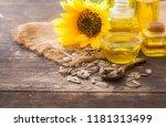 sunflower oil in bottle glass... | Shutterstock . vector #1181313499