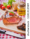 roasted lamb cooking for easter | Shutterstock . vector #1181313589