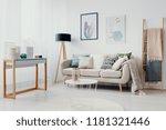 beige couch between ladder and... | Shutterstock . vector #1181321446