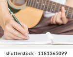 male songwriter hands writing a ... | Shutterstock . vector #1181365099