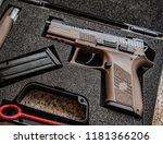 modern pistol on the table in... | Shutterstock . vector #1181366206