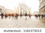 blurred people walking in front ... | Shutterstock . vector #1181373013