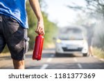 man with a fire extinguisher... | Shutterstock . vector #1181377369