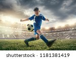 young boy with soccer ball... | Shutterstock . vector #1181381419