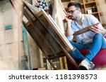 portrait of male artist working ... | Shutterstock . vector #1181398573