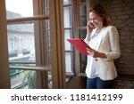 smiling business female talking ... | Shutterstock . vector #1181412199