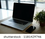 laptop and phone on a wooden...   Shutterstock . vector #1181429746