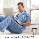 doctor in blue scrubs relaxing... | Shutterstock . vector #11814391