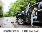young woman in the damaged car... | Shutterstock . vector #1181463460