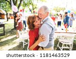 a senior couple dancing on a...   Shutterstock . vector #1181463529