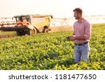 young farmer in filed holding... | Shutterstock . vector #1181477650