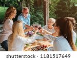 family cheering over the dining ... | Shutterstock . vector #1181517649