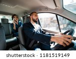smiling driver dirving a car... | Shutterstock . vector #1181519149