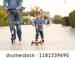 the father walks with the child ... | Shutterstock . vector #1181539690