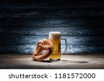 glass of fresh beer and tasty... | Shutterstock . vector #1181572000