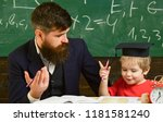 father teaches son mathematics. ...   Shutterstock . vector #1181581240