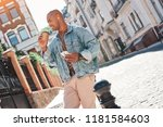music lover. young guy wearing... | Shutterstock . vector #1181584603