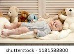 baby boy in striped bodysuit.... | Shutterstock . vector #1181588800
