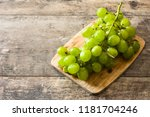 green grapes on wooden table.... | Shutterstock . vector #1181704246