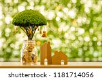 home model and bottle bank and... | Shutterstock . vector #1181714056