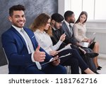 cheerful man showing thumb up... | Shutterstock . vector #1181762716
