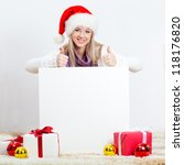 Blonde Woman Wearing Santa Hat...