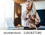 young woman in bathrobe and... | Shutterstock . vector #1181827180