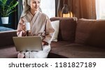 young woman in bathrobe and... | Shutterstock . vector #1181827189