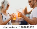 couple cheering with beer.... | Shutterstock . vector #1181843170