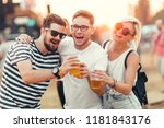 friends drinking beer and... | Shutterstock . vector #1181843176