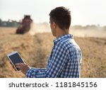 handsome farmer standing in... | Shutterstock . vector #1181845156